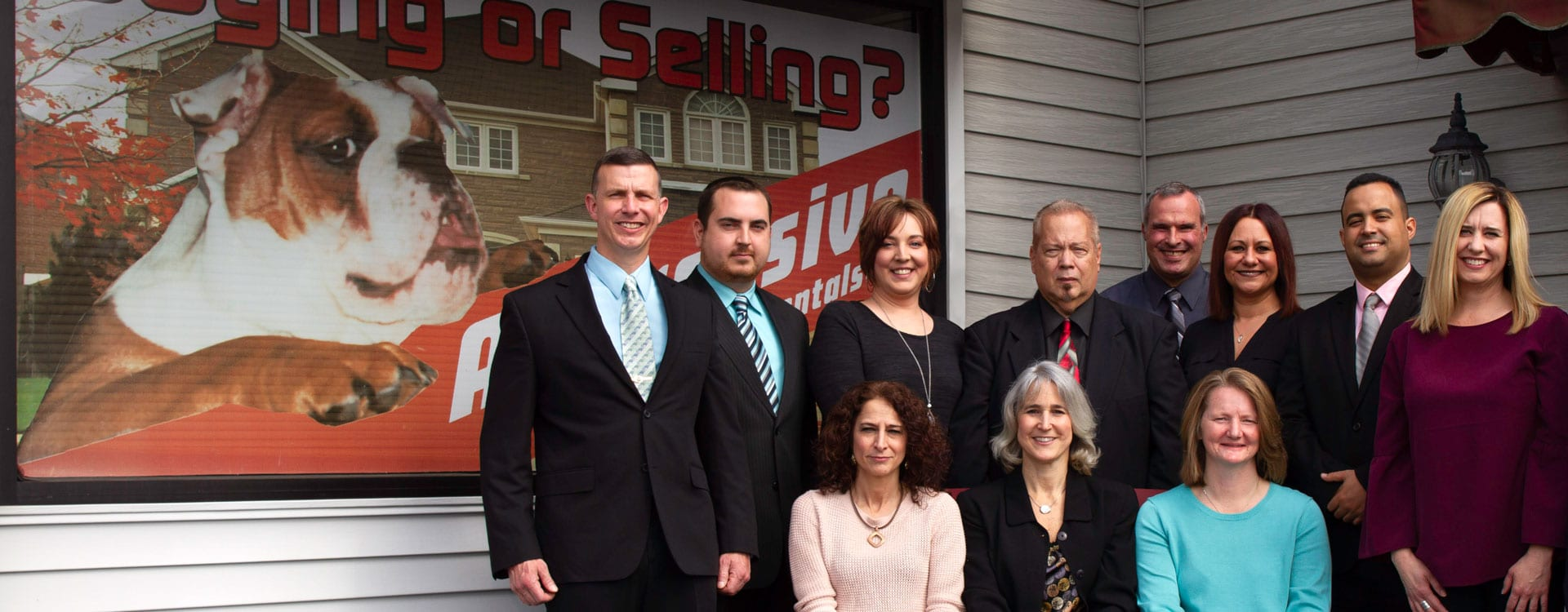 Group photo of the staff at Aggressive Realty